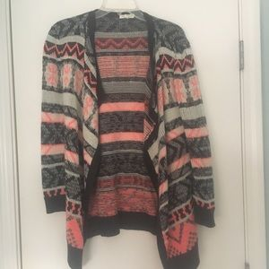 Vestique pink, black, and white sweater
